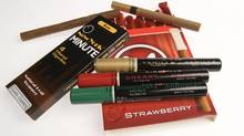 Federal legislation banning cigarillos from being marketed to teens is ineffective because of a loophole manufacturers use to get around the rules. (roger hallett/the globe and mail)