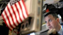 A trader on the floor of the New York Stock Exchange watches the Dow drop Wednesday. Mario Tama/Getty Images (Mario Tama/Getty Images)