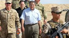 U.S. Defense Secretary Leon Panetta leaves after visiting with American troops at Forward Operating Base Shukvani, Afghanistan, on March 14, 2012. (Scott Olson/Pool/AP/Scott Olson/Pool/AP)
