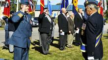 Russ Williams salutes as he arrives at the Battle of Britain parade in Trenton, Ont. in this Sept. 20, 2009. (The Canadian Press)