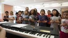 Children practice a dinosaur themed play at the Canadian Opera Company's After School Opera Program at the Pleasantview Community Centre in Toronto. (Matthew Sherwood for The Globe and Mail)