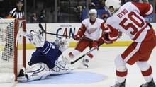 Toronto Maple Leafs goalie Jonas Gustavsson makes a save on a two-on-none breakaway shot by Detroit Red Wings forward Johan Ryno as Jan Mursak looks on during the third period of their preseason game in Toronto. (MARK BLINCH)