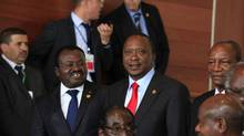 Kenya's President Uhuru Kenyatta, right, is facing charges of crimes against humanity at the International Criminal Court. (STRINGER/REUTERS)