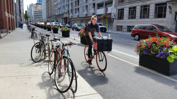 A biker uses the protected bike lanes along Richmond Street West in Toronto's Entertainment District.