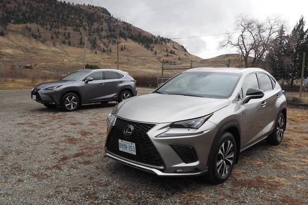 In shots with two Lexus NXs, the darker one (with the pointier nose) is the hybrid.