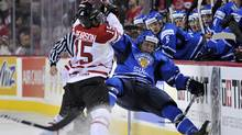 Canada's Tanner Pearson battles Finland's Ville Pokka in the first period of their bronze-medal game. (Todd Korol/Reuters/Todd Korol/Reuters)