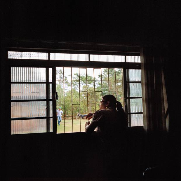 Psychologist Elizeti Moreira looks out the window of the health centre on the Dourados reservation.