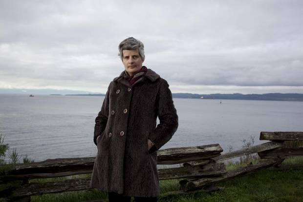 Mayor Lisa Helps is photographed in front of the Strait of Juan de Fuca, where oil tankers pass through regularly if the pipeline expansion is approved.