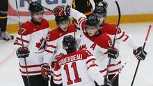 Canada's Ryan Nugent-Hopkins (centre L) celebrates his goal with team mates Dougie Hamilton (L), Jonathan Huberdeau (front), Scott Harrington (2nd R), and J.C. Lipon (R) against Germany in the first period of their preliminary round game during the 2013 IIHF U20 World Junior Hockey Championship in Ufa, December 26, 2012. (MARK BLINCH/REUTERS)