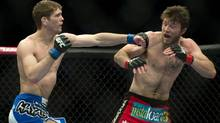 Jordan Mein from Canada, left, lands a blow to the head of Dan Miller from the United States during their UFC 158 welterweight fight in Montreal, Saturday, March 16, 2013. (Graham Hughes/THE CANADIAN PRESS)