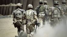 Canadian soldiers rush to reinforce troops after one of their comrades was injured by an IED during a patrol southwest of Kandahar, Afghanistan, on June 7, 2010. (Anja Niedringhaus/AP)
