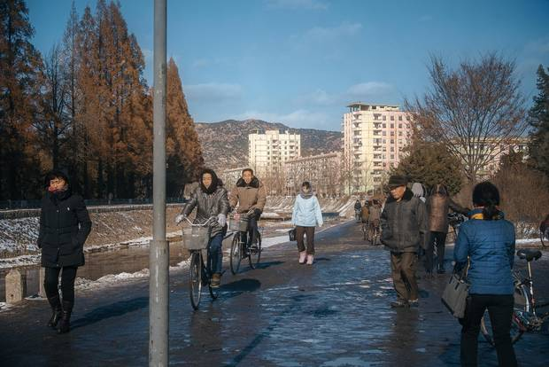 Cyclists and pedestrians share a pathway during the peak morning commute in Kaesong, a city of 200,000 near the border with South Korea.
