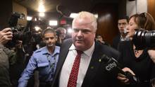 Toronto Mayor Rob Ford heads back to his office after attending a city budget committee meeting on Nov. 25, 2013. (FRED LUM/THE GLOBE AND MAIL)