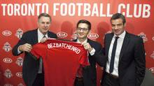 Newly appointed Toronto FC General Manager Tim Bezbatchenko (centre), Maple Leaf Sports and Entertainment President and CEO Tim Leiweke (left) and Toronto FC head coach Ryan Nelsen (JEsse Johnston/The Canadian Press)
