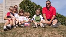 Jen and Scott Lawson relax in a park near their Grimsby, Ontario home with their four children, Sept. 1, 2012. The only thing Jennifer Lawson can't seem to write into her family's daily calendar is free time. (Patrick Dell/The Canadian Press)