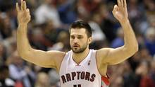 Toronto Raptors forward Linas Kleiza celebrates a three-point basket against the Dallas Mavericks during the second half of their NBA basketball game in Toronto December 14, 2012. (MIKE CASSESE/REUTERS)