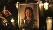 Candles surround a portrait of U.S. Rep. Gabrielle Giffords, who was shot January 8, 2011 in Tuscon, Arizona. (John Moore / Getty Images/John Moore / Getty Images)