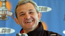 Darryl Sutter smiles during a news conference in San Jose, Calif., Monday, May 10, 2004. (PAUL SAKUMA/Assocaited Press)