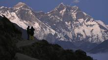 Travellers enjoy the the view of Mount Everest at Syangboche in Nepal. (GOPAL CHITRAKAR/GOPAL CHITRAKAR/REUTERS)