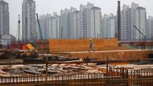 A crew works at a residential construction site in Shanghai on Nov. 17, 2011. (ALY SONG/ALY SONG/REUTERS)