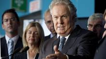 Quebec Liberal Party Leader Jean Charest responds to questions at a news conference Aug. 14, 2012 in Quebec City. (Jacques Boissinot/THE CANADIAN PRESS)