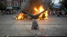An acrobatic protester makes his statement on Queen Street West during G20 protests. (Ian Willms for The Globe and Mail)/Ian Willms for The Globe and Mail))