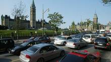 Gridlocked cars are shown in front of the Parliament buildings on Rideau St. in Ottawa Aug. 14, 2003. (JONATHAN HAYWARD/The Canadian Press)