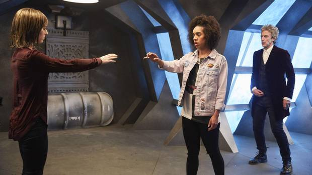 Heather (Stephanie Hyam), Bill (Pearl Mackie) and the Doctor (Peter Capaldi) in a scene from Doctor Who.