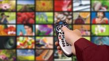 iStockPhoto -- ROYALTY-FREE Digital television. Remote control. Changing Channels, Close-up, Collection, Color Image, Concepts, Digitally Generated Image, Film, Film Industry, Film Reel, Flat Screen, High Definition Television, Holding, Horizontal, Human Body Part, Human Hand, Liquid-Crystal Display, Modern, Photography, Remote Control, Selective Focus, Technology, Television Set, The Media, Video, Video Still, Visual Screen, Watching TV, Wide, Wide Screen (Artur Marciniec/Getty Images/iStockphoto)
