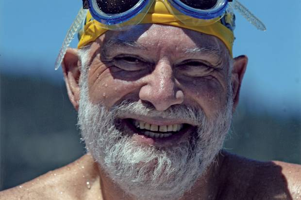 Oliver Sacks emerges from Lake Tahoe in scuba gear.