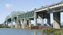 Repair work continues on the Champlain Bridge over the St-Lawrence River. (Paul Chiasson/The Canadian Press)