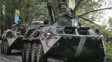Ukrainian army paratroopers move to a position in Slavyansk on June 2, 2014. (EFREM LUKATSKY/ASSOCIATED PRESS)