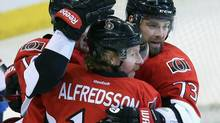 Ottawa Senators' Daniel Alfredsson (11) celebrates a goal with teammates Guillaume Latendresse (73) and Zack Smith (15) during first period NHL hockey action in Ottawa Sunday, March 17, 2013. (FRED CHARTRAND/THE CANADIAN PRESS)