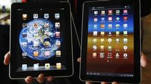 Samsung Electronics' Galaxy tablet (right) are 'not as cool' as Apple Inc's iPad, according to a British judge. (JO YONG-HAK/REUTERS)