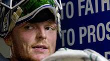 An exhausted Vancouver Canuck goalie Cory Schneider leans against the wall following practice at the UBC Thunderbirds arena on January 8, 2013. (Deborah Baic/The Globe and Mail)