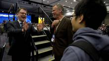 Adrian Dix, left, at the British Columbia NDP Convention in Vancouver, Sunday, Nov. 17, 2013. The party will choose his successor in September, 2014. (JONATHAN HAYWARD/THE CANADIAN PRESS)