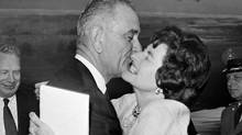 Vice President Lyndon Johnson gets a welcoming kiss from Lady Bird Johnson at Andrews Air Force base on Aug. 21, 1961. (AP)