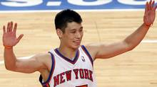 New York Knicks guard Jeremy Lin celebrates after a play in the second quarter of their NBA game against the Sacramento Kings in New York's Madison Square Garden, February 15, 2012. REUTERS/Mike Segar (MIKE SEGAR)