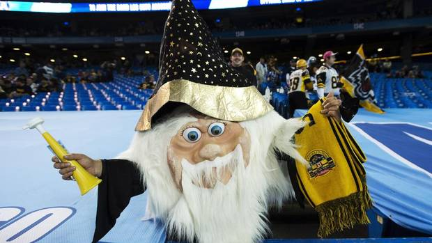 A Hamilton Tiger-Cats fan cheers for the team as they prepare to play the Toronto Argonauts in the CFL eastern conference final in Toronto on Sunday, Nov. 17, 2013. (NATHAN DENETTE/THE CANADIAN PRESS)