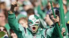 A Saskatchewan Roughriders fan cheers during their CFL game against the Montreal Alouettes in Regina, Saskatchewan October 20, 2012. (DAVID STOBBE/REUTERS)