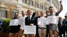 Italian businessmen pose for photographers in their shirts and underwear in tax protest June 4, 2013, in Rome (Remo Casilli/Reuters)