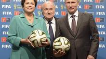 Brazil's President Dilma Rousseff , FIFA President Sepp Blatter and Russia's President Vladimir Putin take part in the official hand over ceremony for the 2018 World Cup (RIA Novosti/REUTERS)