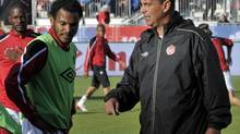 Canada's head coach Stephen Hart talks to his player Julian de Guzman (L) before their international friendly soccer match against the U.S. in Toronto June 3, 2012. (MIKE CASSESE/REUTERS)