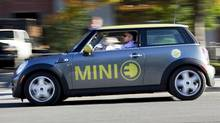 Globe and Mail reporter Peter Cheney test drives the new Electric Mini, the Mini E. (Della Rollins/Della Rollins/THE GLOBE AND MAIL)