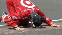 Dario Franchitti, of Scotland, kisses the start/finish line after winning IndyCar's Indianapolis 500 auto race at Indianapolis Motor Speedway in Indianapolis, Sunday, May 27, 2012. (Tom Strattman/AP)