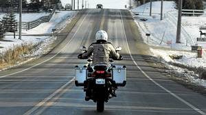 Liz Jansen riding her motorcycle on the roads in Orangeville, December 08 2011.