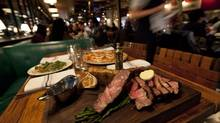Cote de beouf and homemade testina and lobster pizza at the Drake One Fifty Restaurant in downtown Toronto. (Deborah Baic/The Globe and Mail)