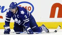 Toronto Maple Leafs Dion Phaneuf grimaces after being injured on a play against the Ottawa Senators during the second period of their NHL hockey game in Toronto, November 2, 2010. (MARK BLINCH)