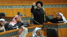 Kuwaiti Islamist-Shiite Member of Parliament Hussein Al Qallaf gesture towards opposing MP's during a heated debate over the situation in Syria in Kuwait's National Assembly's session on Wednesday, Feb. 29, 2012. A citizen of the Gulf Arab country was recently convicted of having insulted the Shi'ite faith and its scholars with comments that damaged Kuwait's image. (Gustavo Ferrari/Gustavo Ferrari/AP)