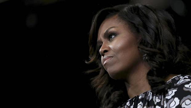 First lady Michelle Obama watches as Democratic presidential nominee Hillary Clinton speaks during a campaign rally last week at Wake Forest University in Winston-Salem, N.C.